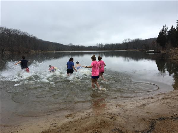 Student Council members plunge into a freezing lake on Feb. 23 to benefit NHS Special Olympics